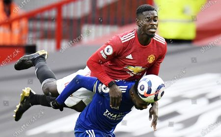 Manchester United's Axel Tuanzebe (top) and Leicester's Kelechi Iheanacho in action during the English Premier League soccer match between Manchester United and Leicester City in Manchester, Britain, 11 May 2021.