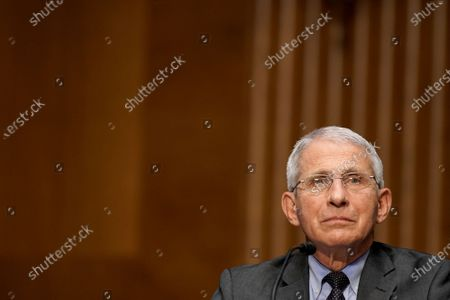 Dr. Anthony Fauci, director of the National Institute of Allergy and Infectious Diseases, listens to Sen. Rand Paul (R-Ky.) question him about gain of function research during a Senate Health, Education, Labor and Pensions Committee hearing to discuss the on-going federal response to Covid-19 at the US Capitol in Washington, DC, USA, 11 May 2021.