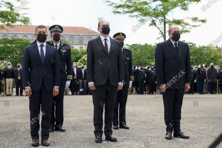 French Prime Minister Jean Castex (C), French Interior Minister Gerald Darmanin (L) and French Justice Minister Eric Dupond-Moretti (R) take part in a ceremony to pay tribute to police officer Eric Masson, who was killed on May 5 during an anti-drug operation, in Avignon , France,  11 May 2021.