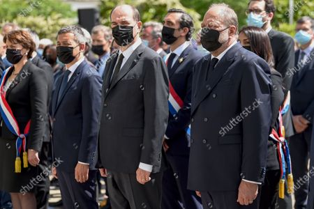 Stock Photo of French Prime Minister Jean Castex (C), flanked by French Interior Minister Gerald Darmanin (L) and French Justice Minister Eric Dupond-Moretti (R) take part in a ceremony to pay tribute to police officer Eric Masson, who was killed on May 5 during an anti-drug operation, in Avignon, France, 11 May 2021.