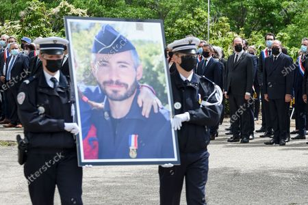 Stock Image of French Justice Minister Eric Dupond-Moretti (R), French Prime Minister Jean Castex (2nd-R) and French Interior Minister Gerald Darmanin (3rd-R) look on as French police officers carry a portrait of police officer Eric Masson, who was killed on May 5 during an anti-drug operation, during an hommage ceremony in Avignon France, 11 May 2021.