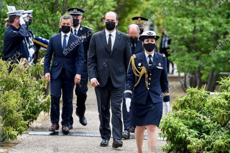 French Prime Minister Jean Castex (C), French Interior Minister Gerald Darmanin (C-L) and French Justice Minister Eric Dupond-Moretti (C-R) attend a ceremony to pay tribute to police officer Eric Masson, who was killed on May 5 during an anti-drug operation, in Avignon, France, 11 May 2021.