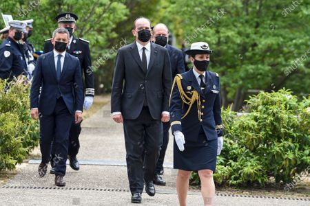Stock Picture of French Prime Minister Jean Castex (C), French Interior Minister Gerald Darmanin (C-L) and French Justice Minister Eric Dupond-Moretti (C-R) attend a ceremony to pay tribute to police officer Eric Masson, who was killed on May 5 during an anti-drug operation, in Avignon, France, 11 May 2021.