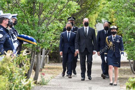 French Prime Minister Jean Castex (C), French Interior Minister Gerald Darmanin (C-L) and French Justice Minister Eric Dupond-Moretti (C-R) attend a ceremony to pay tribute to police officer Eric Masson, who was killed on May 5 during an anti-drug operation, in Avignon , France,  11 May 2021.
