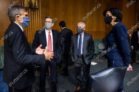 Stock Image of Peter Marks (L), Director of the Center for Biologics Evaluation and Research at the US Food and Drug Administration FDA; David Kessler (C-L), Chief Science Officer for COVID Response at the Department of Health and Human Services (HHS); Anthony Fauci (C-R), Director of the National Institute of Allergy and Infectious Diseases at the National Institutes of Health (NIH); and Rochelle Walensky (R), Director of the US Centers for Disease Control and Prevention (CDC), prepare to testify before a Senate Health, Education, Labor, and Pensions hearing to examine an update from Federal officials on efforts to combat COVID-19 in the Dirksen Senate Office Building in Washington, DC, USA, 11 May 2021.