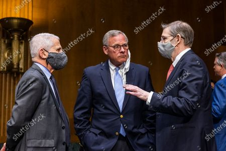 Anthony Fauci (L), Director of the National Institute of Allergy and Infectious Diseases at the National Institutes of Health (NIH), Republican Senator from North Carolina Richard Burr (C), and David Kessler (R), Chief Science Officer for COVID Response at the Department of Health and Human Services (HHS), chat prior to Fauci and Kessler testifying before a Senate Health, Education, Labor, and Pensions hearing to examine an update from Federal officials on efforts to combat COVID-19 in the Dirksen Senate Office Building in Washington, DC, USA, 11 May 2021.