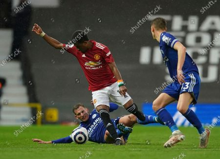Manchester United's Amad Diallo, top left, duels for the ball with Leicester's Marc Albrighton during the English Premier League soccer match between Manchester United and Leicester City, at the Old Trafford stadium in Manchester, England