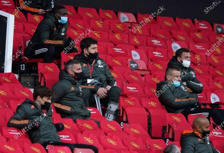 Stock Photo of Manchester United's Harry Maguire, center, looks out from the stands during the English Premier League soccer match between Manchester United and Leicester City, at the Old Trafford stadium in Manchester, England