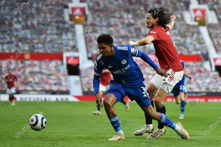 Leicester's Wesley Fofana, left, duels for the ball with Manchester United's Edinson Cavani during the English Premier League soccer match between Manchester United and Leicester City, at the Old Trafford stadium in Manchester, England