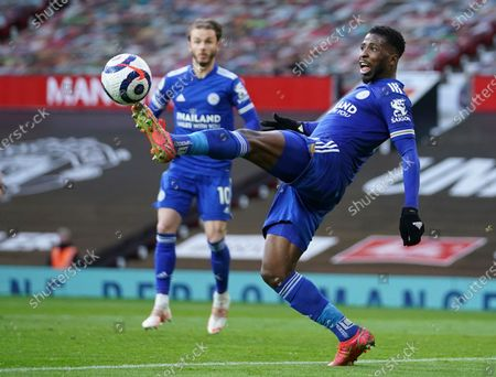 Leicester City's Kelechi Iheanacho kicks the ball during the English Premier League soccer match between Manchester United and Leicester City, at the Old Trafford stadium in Manchester, England