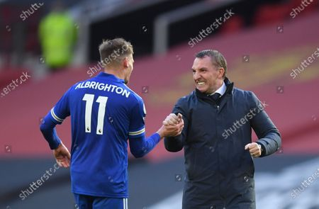 Leicester's manager Brendan Rodgers, right, celebrates with Leicester's Marc Albrighton at the end of the English Premier League soccer match between Manchester United and Leicester City, at the Old Trafford stadium in Manchester, England