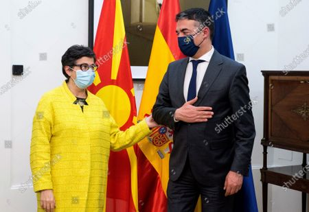 Spanish Foreign Affairs minister Arancha Gonzalez Laya (L) welcomes North Macedonia's counterpart Zoran Zaev (R), during their meeting held at Viana Palace, in Madrid, Spain, 11 May 2021.
