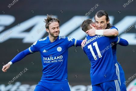 Leicester's Caglar Soyuncu (R) celebrates with Leicester's Marc Albrighton (C) and Leicester's James Maddison (L) after scoring a goal during the English Premier League soccer match between Manchester United and Leicester City in Manchester, Britain, 11 May 2021.