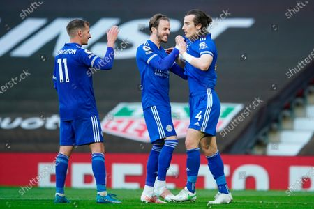 Leicester's Caglar Soyuncu (R) celebrates with Leicester's Luke Thomas (C) and Leicester's Marc Albrighton (L) after scoring a goal during the English Premier League soccer match between Manchester United and Leicester City in Manchester, Britain, 11 May 2021.