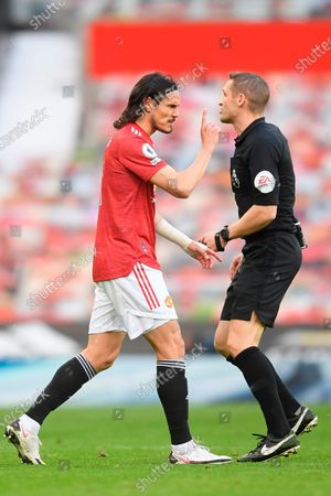 Manchester United's Edinson Cavani (L) talks tot the referee during the English Premier League soccer match between Manchester United and Leicester City in Manchester, Britain, 11 May 2021.