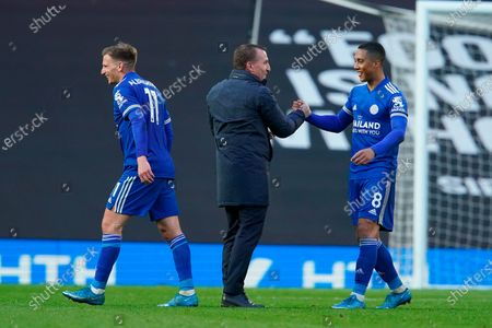 (L-R) Leicester's Marc Albrighton, Leicester's manager Brendan Rodgers and Leicester's Youri Tielemans celebrate after the English Premier League soccer match between Manchester United and Leicester City in Manchester, Britain, 11 May 2021.