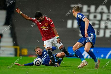 Leicester's Marc Albrighton (L) and Manchester United's Amad Diallo (R) in action during the English Premier League soccer match between Manchester United and Leicester City in Manchester, Britain, 11 May 2021.