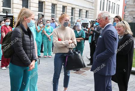 Stock Picture of Prince Charles, Prince Charles speaks with nursing staff during a visit to St Bartholomew's Hospital, ahead of International Nurses Day at St Bartholomew's Hospital on May 11, 2021 in London, England.