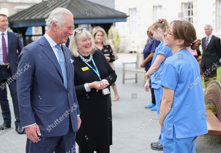 Prince Charles, Prince Charles speaks with nursing staff during a visit to St Bartholomew's Hospital, ahead of International Nurses Day at St Bartholomew's Hospital on May 11, 2021 in London, England.