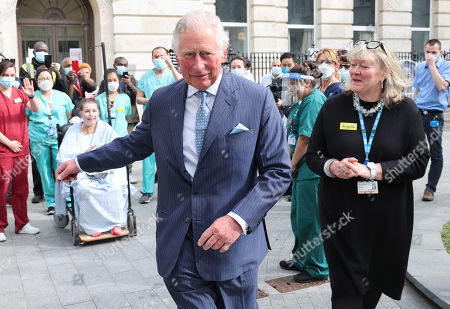 Prince Charles, Prince Charles departs after speaking with nursing staff during a visit to St Bartholomew's Hospital, ahead of International Nurses Day at St Bartholomew's Hospital on May 11, 2021 in London, England.
