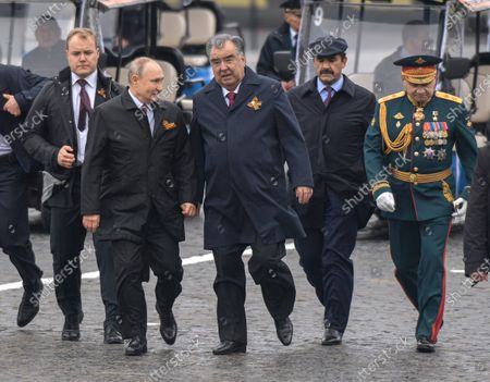 Stock Photo of A military parade on Red Square, dedicated to the 76th anniversary of Victory in the Great Patriotic War. Russian President Vladimir Putin (second left), Tajik President Emomali Rahmon (center) and Russian Defense Minister Sergey Shoygu (right) before laying flowers at the Tomb of the Unknown Soldier after the parade.May 09, 2021.