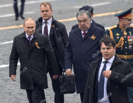 Stock Picture of A military parade on Red Square, dedicated to the 76th anniversary of Victory in the Great Patriotic War. Russian President Vladimir Putin (left), Tajik President Emomali Rahmon (center) and Russian Defense Minister Sergey Shoygu (right) before laying flowers at the Tomb of the Unknown Soldier after the parade.May 09, 2021.