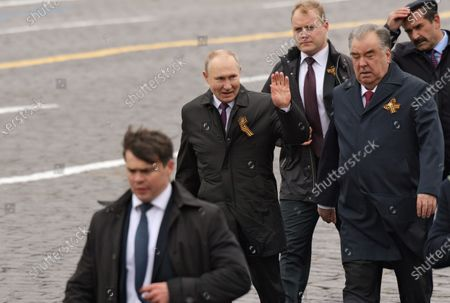 Celebrating Victory Day. A military parade on Red Square, dedicated to the 76th anniversary of Victory in the Great Patriotic War. Russian President Vladimir Putin (second left) and Tajik President Emomali Rahmon (second right) before the parade.May 09, 2021.