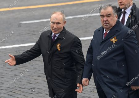 Military parade on Red Square, dedicated to the 76th anniversary of Victory in the Great Patriotic War. Russian President Vladimir Putin (left) and Tajik President Emomali Rahmon (right) before laying flowers at the Tomb of the Unknown Soldier after the parade.May 09, 2021.