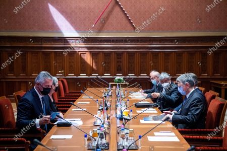 Speaker of the Hungarian Parliament Laszlo Kover (R) and Montenegrin President Milo Djukanovic (L) start talks in the Parliament building in Budapest, Hungary, 11 May 2021.