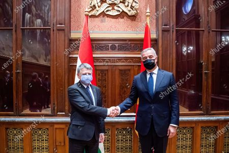 Speaker of the Hungarian Parliament Laszlo Kover (R) welcomes Montenegrin President Milo Djukanovic (L) in the Parliament building in Budapest, Hungary, 11 May 2021.