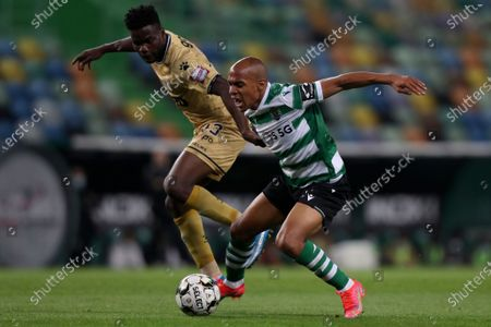 Sporting's Joao Mario vies for the ball with Boavista's Show, left, during the Portuguese League soccer match between Sporting CP and Boavista FC at the Alvalade stadium in Lisbon