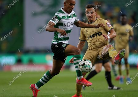 Sporting's Joao Mario, left, vies for the ball with Boavista's Hamache during the Portuguese League soccer match between Sporting CP and Boavista FC at the Alvalade stadium in Lisbon