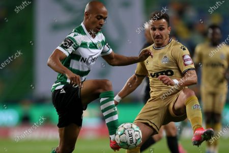 Sporting's Joao Mario, left, controls the ball next to Boavista's Hamache during the Portuguese League soccer match between Sporting CP and Boavista FC at the Alvalade stadium in Lisbon