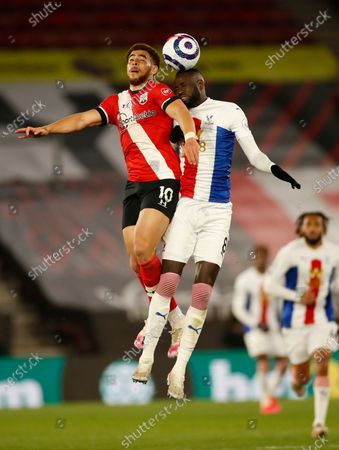 Southampton's Che Adams, left jumps for the ball with Crystal Palace's Cheikhou Kouyate during an English Premier League soccer match between Southampton and Crystal Palace at St Mary's Stadium in Southampton, England