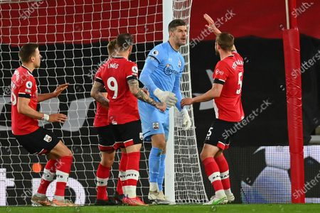 Stock Image of Southampton's goalkeeper Fraser Forster is congratulated by team mated after saving a penalty during an English Premier League soccer match between Southampton and Crystal Palace at St Mary's Stadium in Southampton, England