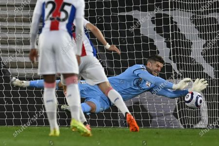 Southampton's goalkeeper Fraser Forster saves a penalty taken by Crystal Palace's Luka Milivojevic during an English Premier League soccer match between Southampton and Crystal Palace at St Mary's Stadium in Southampton, England