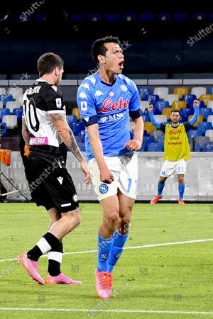 Napoli's forward Hirving Lozano (R) jubilates after scoring the 3-1 goal during the italian Serie A soccer match  SSC Napoli vs  Udinese Calcio at the Diego Armando Maradona stadium in Naples, Italy, 11 May 2021.