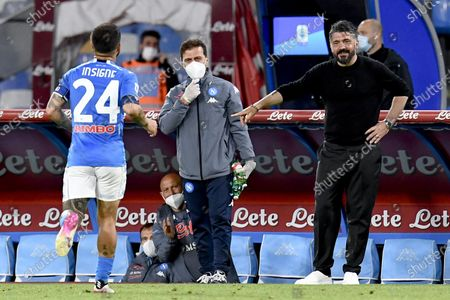 Napoli's forward Lorenzo Insigne celebrates with  head coach Gennaro Gattuso after scoring the 5-1 during the italian Serie A soccer match  SSC Napoli vs  Udinese Calcio at the Diego Armando Maradona stadium in Naples, Italy, 11 May 2021.
