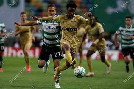 Alberth Elis of Boavista FC (R ) vies with Joao Pereira of Sporting CP during the Portuguese League football match between Sporting CP and Boavista FC at Jose Alvalade stadium in Lisbon, Portugal on May 11, 2021.