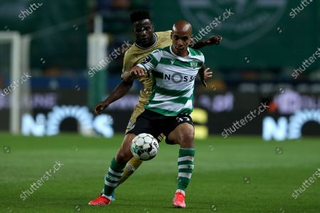 Stock Photo of Joao Mario of Sporting CP (R ) vies with Show of Boavista FC during the Portuguese League football match between Sporting CP and Boavista FC at Jose Alvalade stadium in Lisbon, Portugal on May 11, 2021.