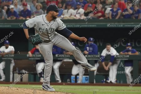 Stock Picture of Seattle Mariners relief pitcher Aaron Fletcher throws against the Texas Rangers during a baseball game, in Arlington, Texas
