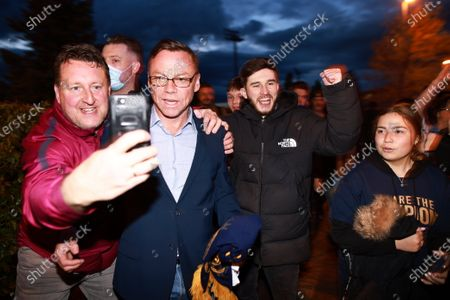 Stock Photo of PAUL DICKOV with fans. Manchester City fans celebrate outside the Etihad Stadium after their team wins the Premiership following Manchester United's loss at home to Leicester City this evening (11th May 2021).