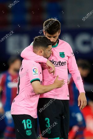 Gerard Pique and Jordi Alba of Barcelona  greets each other during the La Liga Santander match between Levante UD and FC Barcelona at Ciutat de Valencia Stadium on May 11, 2021 in Valencia, Spain. Sporting stadiums around Spain remain under strict restrictions due to the Coronavirus Pandemic as Government social distancing laws prohibit fans inside venues resulting in games being played behind closed doors.