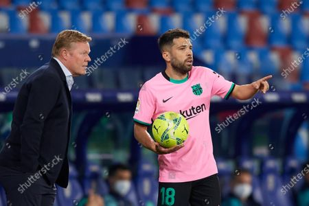Ronald Koeman head coach of Barcelona and Jordi Alba of Barcelona talk during the La Liga Santander match between Levante UD and FC Barcelona at Ciutat de Valencia Stadium on May 11, 2021 in Valencia, Spain. Sporting stadiums around Spain remain under strict restrictions due to the Coronavirus Pandemic as Government social distancing laws prohibit fans inside venues resulting in games being played behind closed doors.