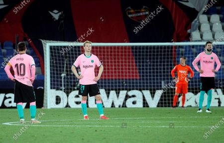 FC Barcelona's (L-R) Leo Messi, Frenkie de Jong and Gerard Pique react during the Spanish LaLiga soccer match between Levante UD and FC Barcelona at Ciutat de Valencia stadium in Valencia, eastern Spain, 11 May 2021.