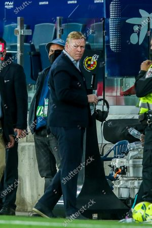 Stock Photo of Barcelona's head coach Ronald Koeman leaves the pitch at the end of the Spanish La Liga soccer match between Levante and FC Barcelona at the Ciutat de Valencia stadium in Valencia, Spain