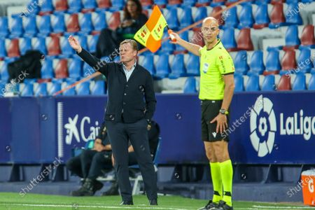 Stock Picture of Barcelona's head coach Ronald Koeman gestures during the Spanish La Liga soccer match between Levante and FC Barcelona at the Ciutat de Valencia stadium in Valencia, Spain