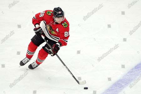 """Chicago Blackhawks right wing Patrick Kane skates with the puck during an NHL hockey game against the Dallas Stars, in Chicago. """"I miss him in a lot of ways,"""" Kane said Tuesday, about teammate Jonathan Toews. """"Off the ice obviously he's a good leader, great friend. You miss him just in that sense. On the ice for me, it makes it a lot easier, too"""