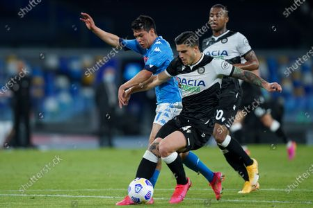Hirving Lozano of SSC Napoli and Kevin Bonifazi of Udinese Calcio compete for the ball during the Serie A match between Napoli and Udinese at Stadio Diego Armando Maradona, Naples, Italy on 11 May 2021.