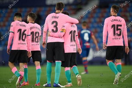 Lionel Messi of FC Barcelona celebrates his goal with Gerard Pique